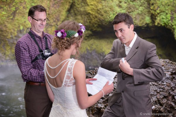 Bride and Groom exchange vows at Wahclella waterfall wedding in the Columbia River Gorge.