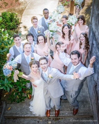 Portrait of a bride, groom and wedding party celebrating after a summer wedding ceremony on Persimmon Golf Course in Oregon.