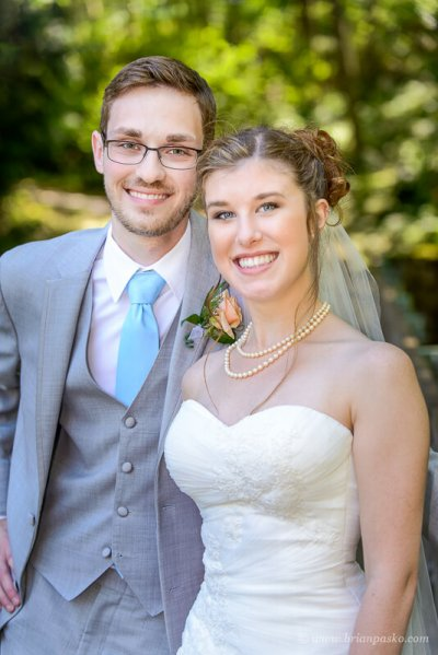 Portrait of a beautiful bride and groom at summer wedding ceremony on Persimmon Golf Course in Oregon.