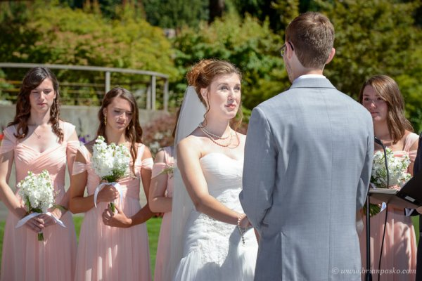 Portrait of a beautiful bride saying vows to her groom at summer wedding on Persimmon Golf Course in Oregon.