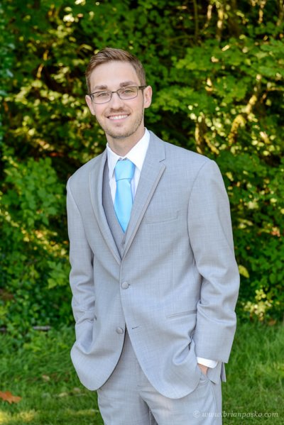 Portrait of a dapper groom before his summer wedding ceremony on Persimmon Golf Course in Oregon.