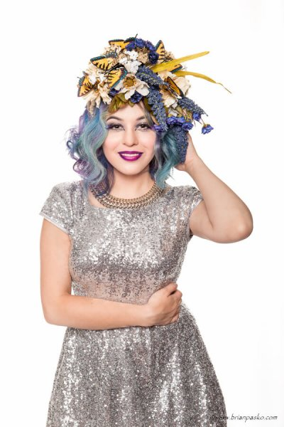 High key fashion Portrait of beautiful model wearing butterfly hair piece and high fashion makeup.