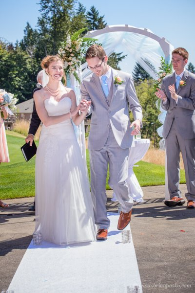 Portrait of husband and wife at their summer wedding ceremony on Persimmon Golf Course in Oregon.