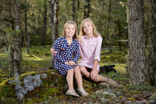 Family portrait of two girl sisters in the forest near the Sandy River wearing dressing in fall.