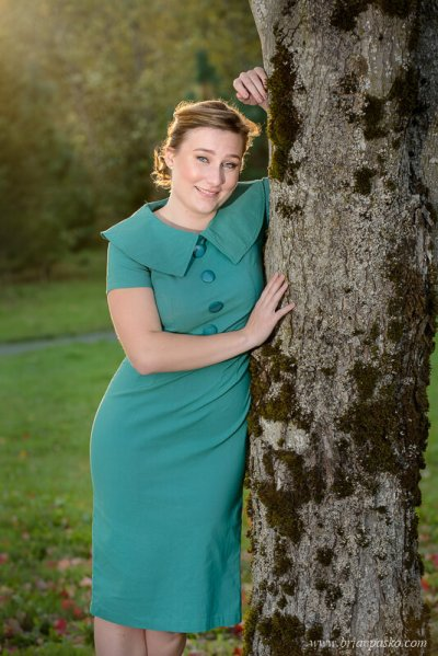 Portrait of a Glencoe High School senior girl with backlit picture in teal dress and tree