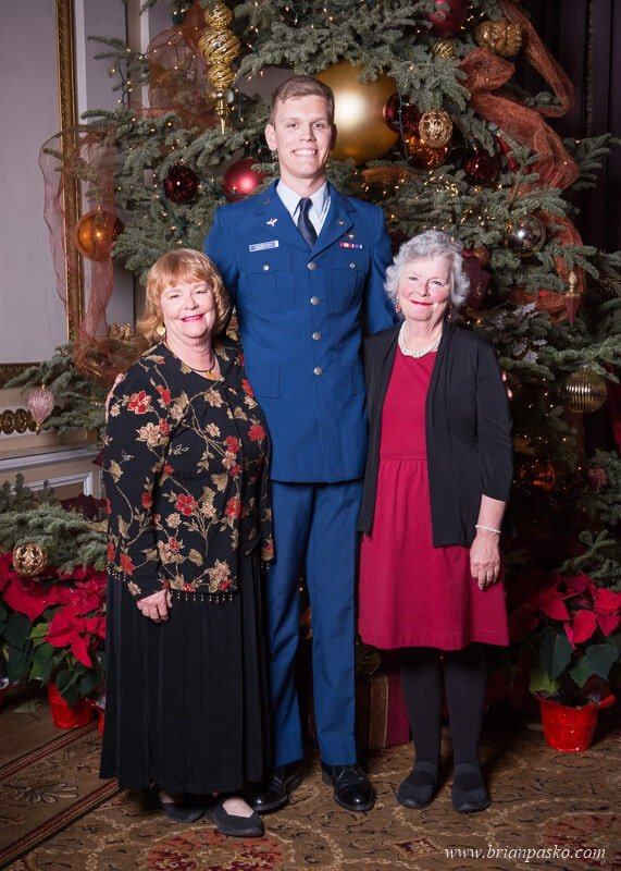 Portrait of an Air Force Cadet and his two grandmothers at the All Services Academies Ball at the Benson Hotel in Portland, Oregon.