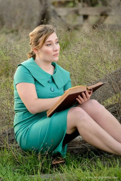 Glencoe High School senior portrait with picture of girl reading a vintage book in a field.