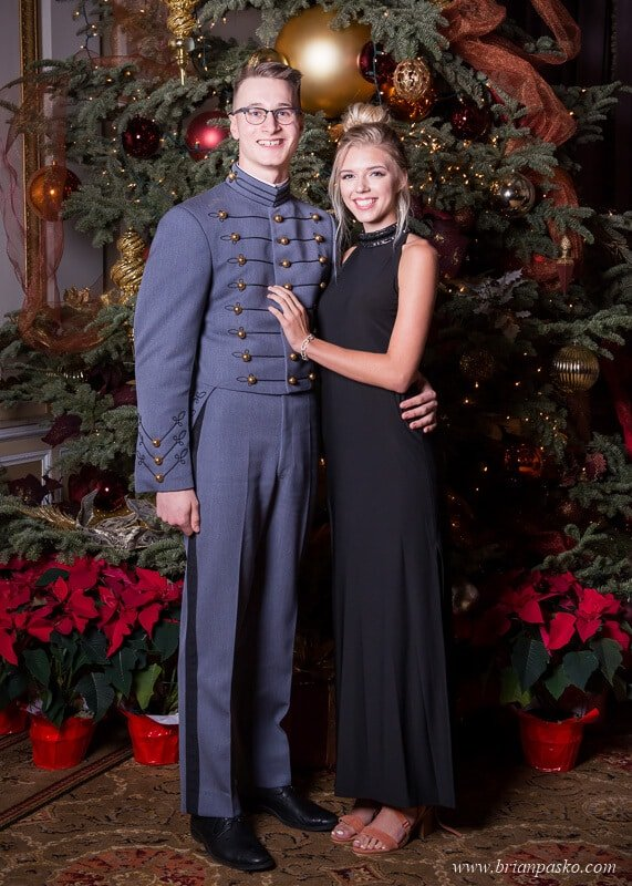 Portrait of a West Point Marine Corps Cadet and his date at the All Services Academies Ball at the Benson Hotel in Portland, Oregon.