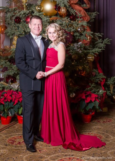 Portrait of two parents at the All Services Academies Ball at the Benson Hotel in Portland, Oregon.