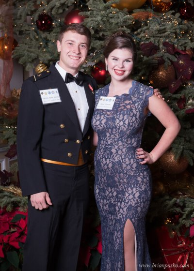 Portrait of a Naval Academy Cadet and his date at the All Services Academy Ball at the Benson Hotel in Portland, Oregon.