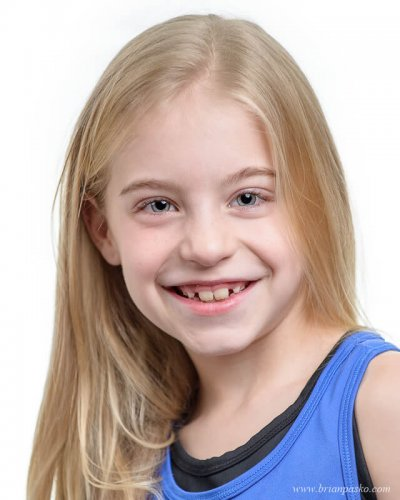 Professional headshot portrait of an eight year old girl for competitive dance,
