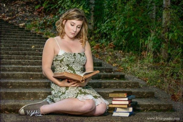 Senior Portrait of Glencoe High School girl reading vintage books on stone stairs.