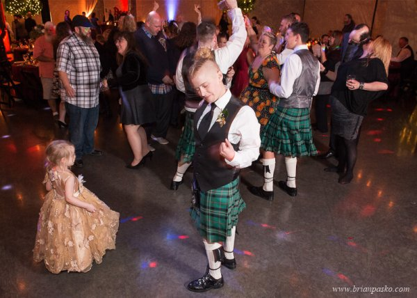 Groomswoman and flower girl dance at wedding at the Castaway in Portland, Oregon.