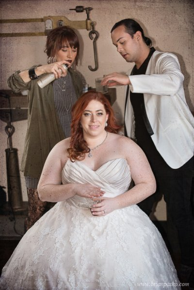 Hair and Makeup artists attending to the Bride's hair during her wedding day at the Castaway in Portland, Oregon.