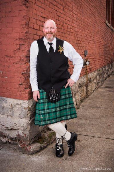 Portrait of the Groom wearing a Scottish Kilt at wedding at the Castaway in Portland, Oregon.
