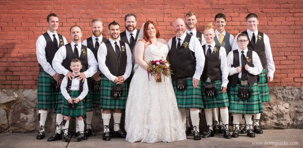 Portrait of Bride with Groom and Groomsmen wearing Scottish kilts at wedding at the Castaway in Portland, Oregon.