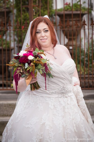 Portrait of the Bride and her wedding bouquet at wedding at the Castaway in Portland, Oregon.