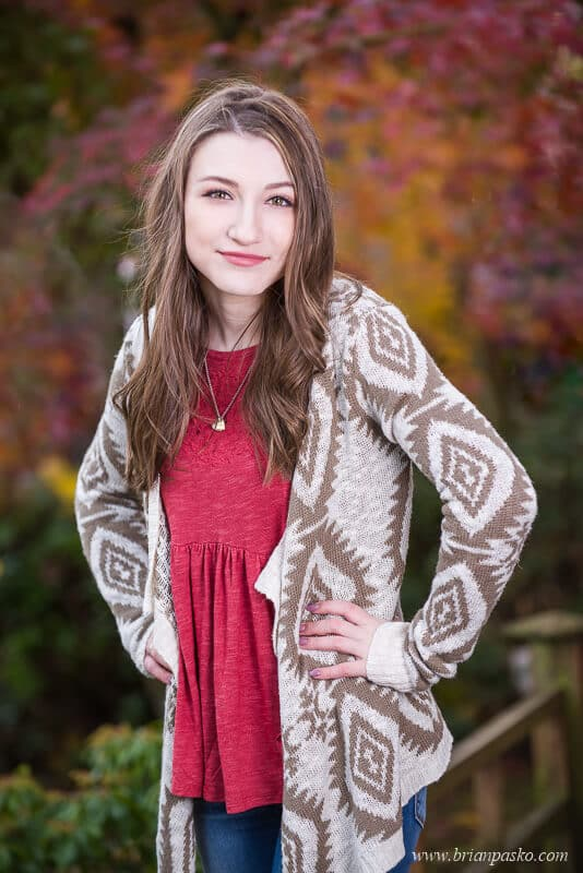 Hillsboro High School senior portrait of girl with picture in fall colors in Portland, Oregon.