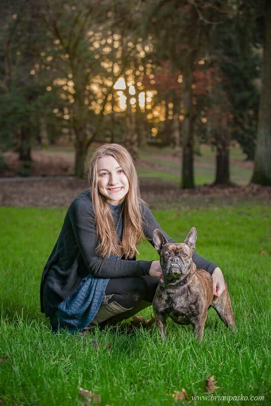 Senior Picture of Hillsboro High School senior girl with a portrait of her French Bulldog in Portland Oregon park.
