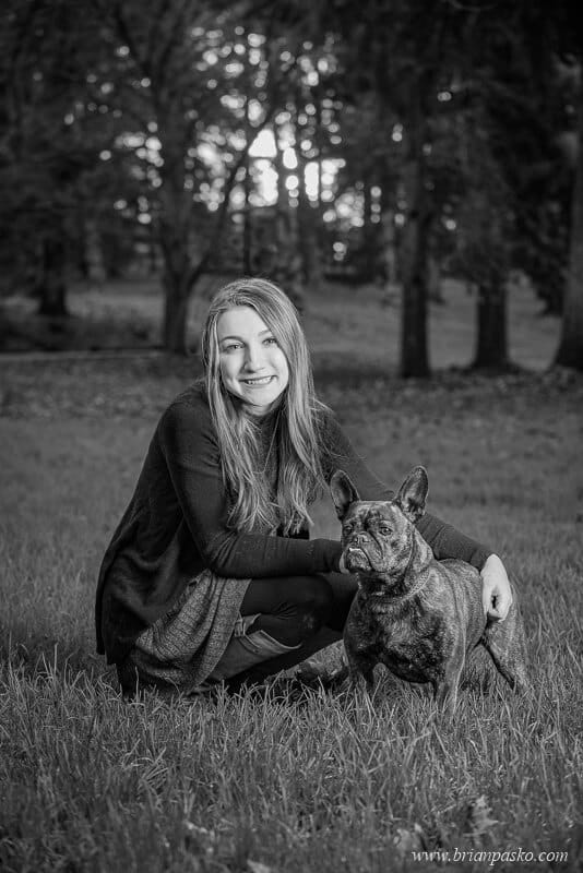 Senior Picture of Hillsboro High School senior girl with a portrait of her French Bulldog in Black and White.