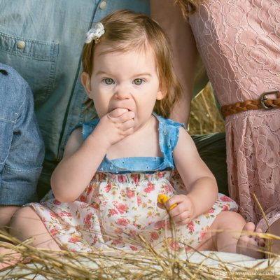 Humorous portrait of a thirteen month old baby eating goldfish during a family portrait session at Powell Butte Nature Park in Portland, Oregon.