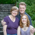 Family portrait of Lake Oswego high school senior and her parents at Lewis and Clark College in Portland, Oregon.