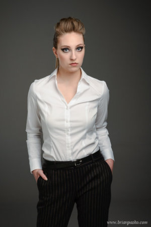Fashion portrait of woman in business casual outfit.