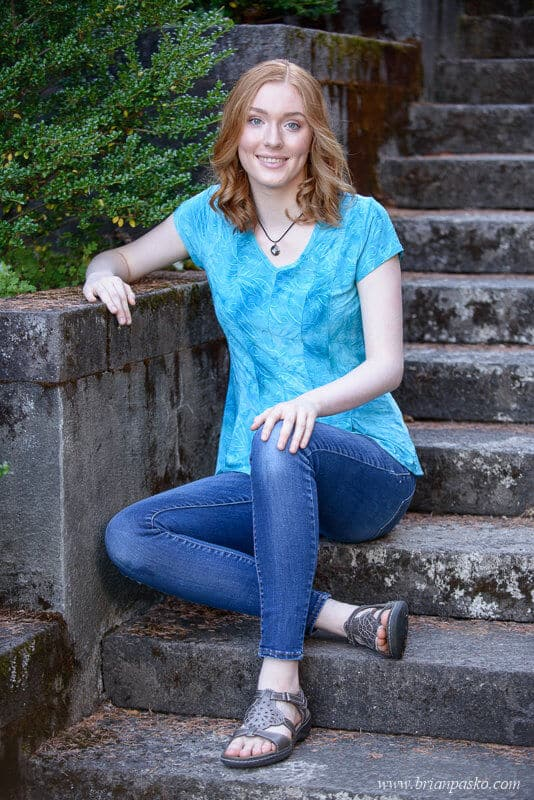 Lake Oswego High School senior portrait of girl on stairs at Lewis and Clark College in Portland, Oregon.