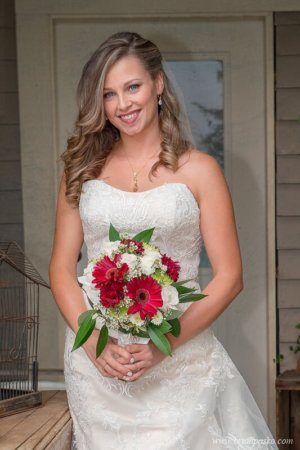 Portrait of a bride and her bouquet before her wedding outside a Victorian home at the Heisen House Vineyard in Battle Ground Washington.