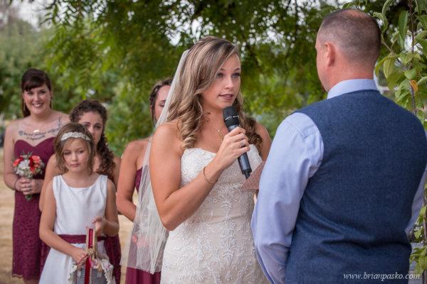 Bride saying her vows at the Heisen House Vineyard in Battle Ground Washington.