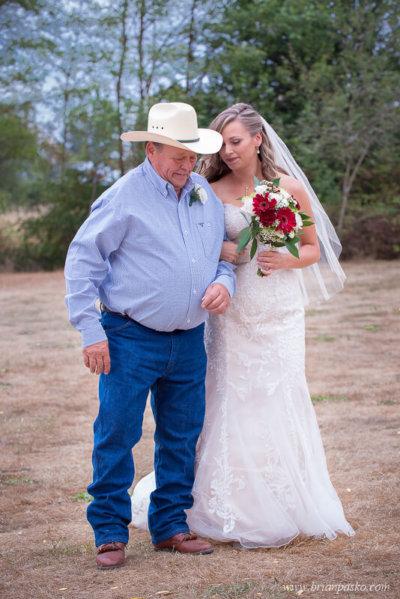 Father walking bride to her wedding ceremony at the Heisen House Vineyard in Battle Ground Washington.