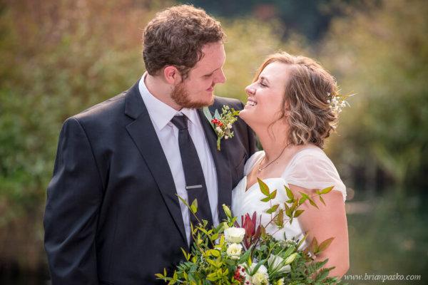Bride and Groom laughing together at Laurelhurst Park wedding in Portland.