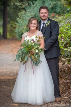 Bride and Groom standing on trail in Laurelhurst Park in Portland.