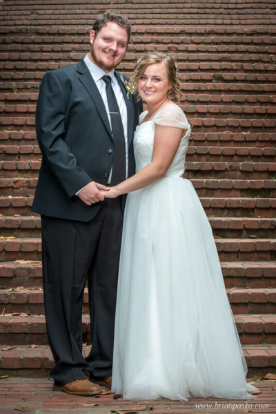 Bride and Groom at bottom of brick stairs at Laurelhurst Park in Portland.