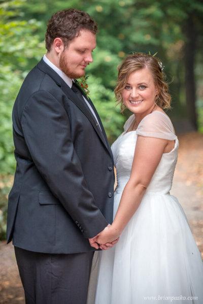 Bride and groom holding hands before wedding near Laurelhurst Park in Portland.