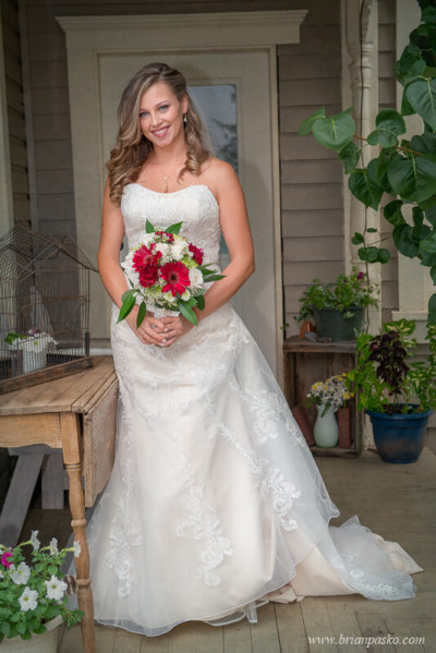 Bride standing in front of Victorian home at the Heisen House Vineyard in Battle Ground Washington.
