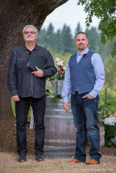 Groom and wedding officiant waiting for bride at the Heisen House Vineyard in Battle Ground Washington.
