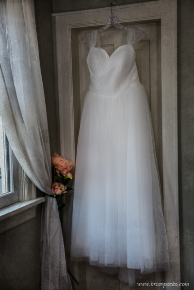 Bride's dress hangng near a window of a home near Laurelhurst Park in Portland, Oregon.