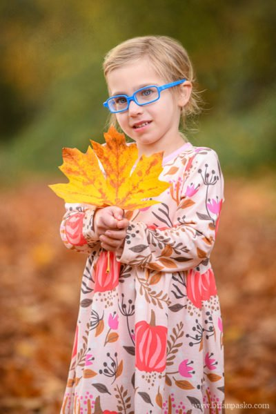 Children-portraits-of-4-year-old-Girl-in-Fall-Big-Leaf