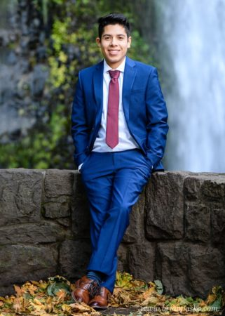 Clackamas High School Senior in Columbia River Gorge with Suit by Waterfall and Rock Wall