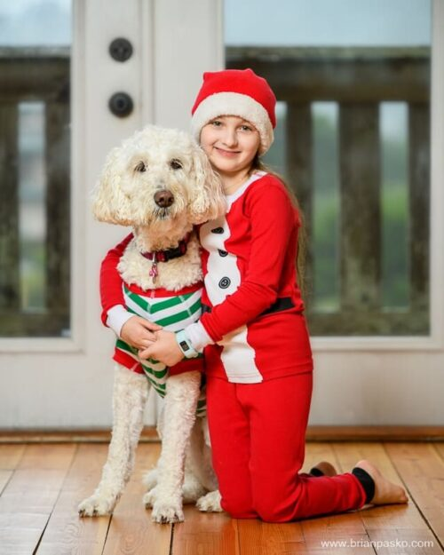 Holiday Card Portrait with Elf Pajamas - Girl Hugging Dog